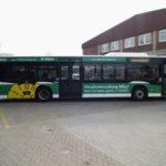 DEKRA Stade TÜV und AU Verkehrsmittelwerbung Bus Vollverklebt Grün mit TÜV Siegel